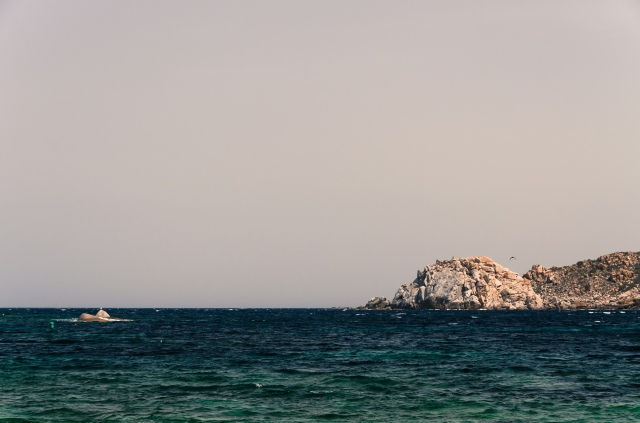 A promontory viewed from the Spiaggia di Cala Spinosa in Sardinia