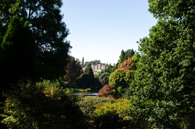 Sheffield Park House framed by foliage